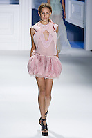 Karolina Waz walks runway in a rose textured silk V-neck drawstring top with super piqu6 criss cross hooded cutaway overlay Rose organza and tulle drawstring bubble skirt by Vera Wang, for the Vera Wang Spring 2012 collection, during Mercedes-Benz Fashion Week Spring 2012.