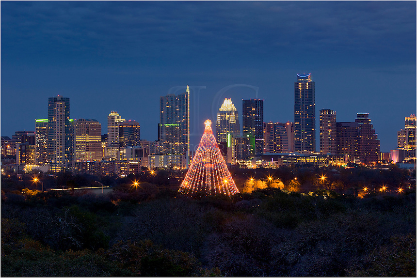 With the Austin skyline in the background, this image shows the annually lit Austin Christmas tree in Zilker Park