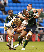 Reading, Berks, ENGLAND, 15.04.2006,Exiles Sailosi Tagicakibau, is Tackled by the Tykes, Justin Marshall [left] and Roland De Marigny during the Guinness Premiership match, London Irish vs Leed Tykes, Madejski Stadium,  © Peter Spurrier/Intersport-images.com.