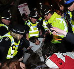 Protesters arrested at the Cambridge Union Society,.Dominique Strauss-Kahn the French economist, lawyer.and politician, rushed into a side door, who served as the Managing Director of.the International Monetary Fund