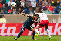 Tim Cahill (17) of the New York Red Bulls ties up Rafael Garcia (25) of the Los Angeles Galaxy. The New York Red Bulls defeated the Los Angeles Galaxy 1-0 during a Major League Soccer (MLS) match at Red Bull Arena in Harrison, NJ, on May 19, 2013.