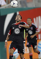 WASHINGTON, DC. - AUGUST 22, 2012:  Dwayne DeRosario (7) of DC United goes for a high ball against the Chicago Fire during an MLS match at RFK Stadium, in Washington DC,  on August 22. United won 4-2.