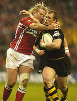 Twickenham, London, ENGLAND, Llanelli Scarlets,  Alix Popham, tackles Wasps Josh Lewsey, during the Powergen Cup Final between  London Wasps vs Llanelli Scarlets, at the RFU Stadium on Sunday 09.04.2006, © Peter Spurrier/Intersport-images.com.   [Mandatory Credit, Peter Spurier/ Intersport Images].