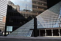 Philip Johnson: Pennzoil Place, Houston. Milam St. entrance, 1975.  Pyramid-shaped atrium. Post-modern.  Photo '80.