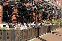 People eating lunch outdoors at Earls restaurant  in Yaletown, Vancouver, British Columbia, Canada