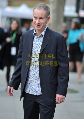 JOHN McENROE.9th Annual Tribeca Film Festival - Vanity Fair Party held at at New York State Supreme Court, New York, NY, USA, .20th April 2010..half length navy blue white star stars print shirt heart hearts jacket .CAP/ADM/BM.©Bill Menzel/AdMedia/Capital Pictures.