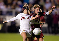 Alyssa Pember (6) of Boston College fights for the ball with Camille Levin (2) of Stanford during the second game of the NCAA Women's College Cup at WakeMed Soccer Park in Cary, NC.  Stanford defeated Boston College, 2-0.