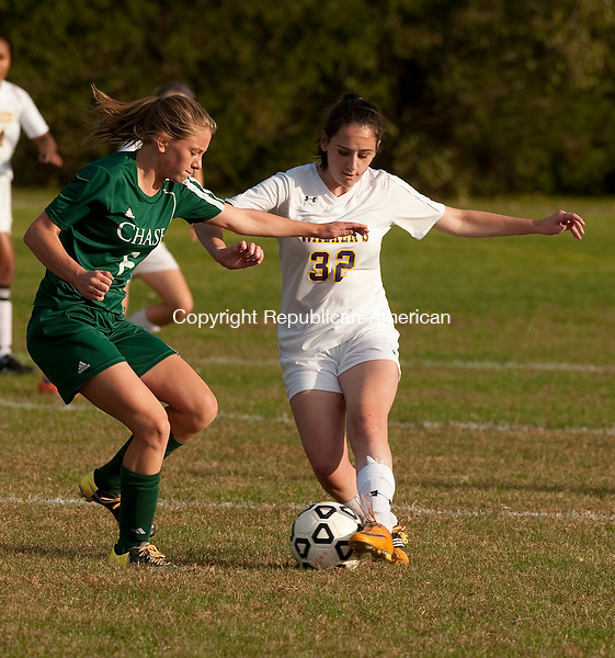 WATERBURY, CT--- -102115JS13---Chase's Malina Lacapra (6)  and Ethel Walker's Caroline Castonguay (23) battle for the ball during their game Wednesday at Chase Collegiate School in Waterbury. <br /> Jim Shannon Republican-American