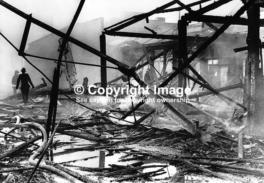 Smouldering remains of Smithfield Market, Belfast, N Ireland, following an overnight fire. 7th May 1974. The huge fire completely gutted the area. 1974050701SM1..Copyright Image from Victor Patterson, 54 Dorchester Park, Belfast, United Kingdom, UK...For my Terms and Conditions of Use go to http://www.victorpatterson.com/Victor_Patterson/Terms_%26_Conditions.html