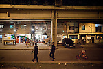 Pacifying Police officers Carla Bon, right, and D&eacute;borah Rocha, left, during patrol in Complexo do Caju, Rio de Janeiro, Brazil, on Friday May 10, 2013.<br /> <br /> In the early hours of Sunday, March 3, 2013, about 1,400 Brazilian security forces occupied 13 communities during a joint public security operation to install a Pacifying Police Unit (UPP) in two Rio de Janeiro favelas, Complexo do Caju and Barreira do Vasco. Elite police units backed by armored military vehicles and helicopters invaded the neighborhood in an on-going policing program aimed to drive violent and heavily armed drug gangs out of Rio's poor communities, where the traffickers have ruled for decades. For the community of Caju, that is ADA (Amigos de Amigos) and CV (Comando Vermelho).