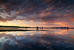 A beautiful clouded sky is reflected in Lake Yellowstone in Wyoming. It is the largest freshwater lake above 7000 feet in North America.