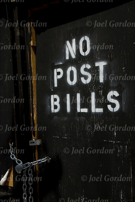 Spray paint sign on wall, No Post Bills such have been Post No Bills