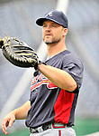 24 September 2011: Atlanta Braves catcher David Ross warms up prior to a game against the Washington Nationals at Nationals Park in Washington, DC. The Nationals defeated the Braves 4-1 to even up their 3-game series. Mandatory Credit: Ed Wolfstein Photo