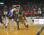 "Ole Miss guard Chris Warren (12)  loses the ball off his foot at the C.M. ""Tad"" Smith Coliseum in Oxford, Miss. on Wednesday, February 9, 2011. Ole Miss won 66-60 and is now 4-5 in the Southeastern Conference."