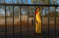 An Indian women next to the road in central Mumbai, view from the car window, India