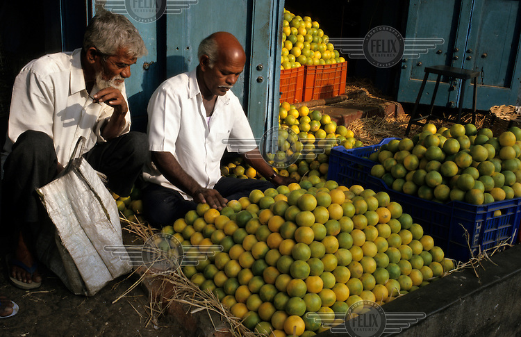 An orange seller in the city market.