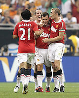 Darren Fletcher #24 and John O'Shea #22 with Rafael #21 of Manchester United congratulate Darron Gibson #28 for scoring on a free kick during the 2010 MLS All-Star match against the MLS All-Stars at Reliant Stadium, on July 28 2010, in Houston, Texas. Manchester United won 5-2.