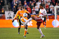 Lovel Palmer (22) of the Houston Dynamo and Juan Agudelo (17) of the New York Red Bulls look to play the ball. The New York Red Bulls  and the Houston Dynamo played to a 1-1 tie during a Major League Soccer (MLS) match at Red Bull Arena in Harrison, NJ, on April 02, 2011.