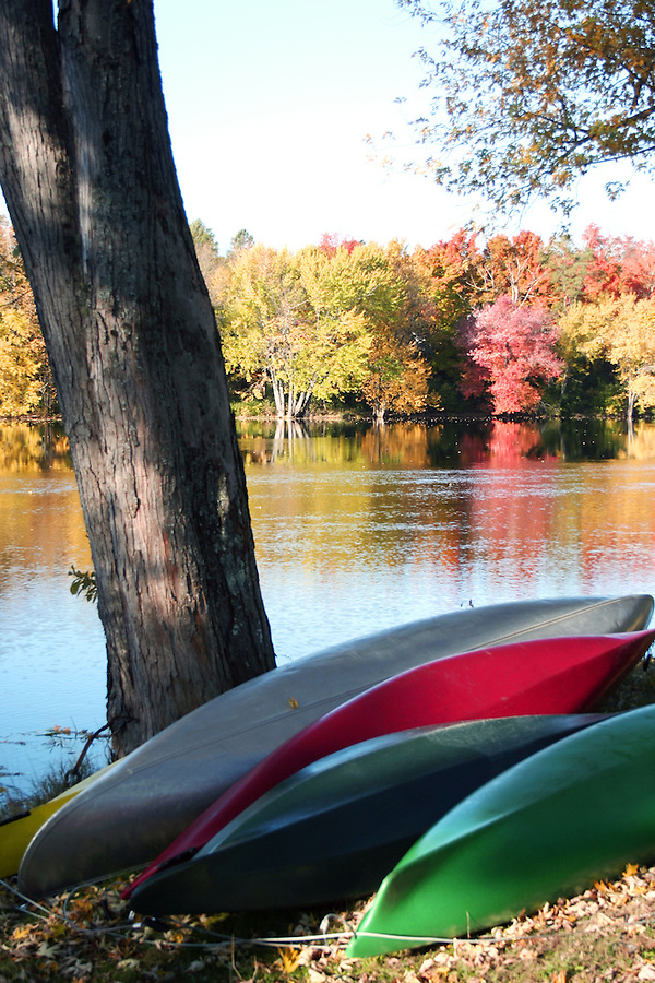 Canoes on riverbank in Orono, Maine