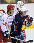 Ion-Georgy Kostev (Russia - 13), Kenny Ryan (US - 20) - Team USA defeated Team Russia 6-0 in their final game during the 2009 USA Hockey National Junior Evaluation Camp on Saturday, August 15, 2009, in the USA (NHL-sized) Rink in Lake Placid, New York.