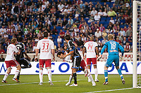 Rafa Marquez (4) of the New York Red Bulls wrestles with Shea Salinas (6) of the San Jose Earthquakes during a corner kick in the 18th minute of a Major League Soccer (MLS) match at Red Bull Arena in Harrison, NJ, on April 14, 2012.