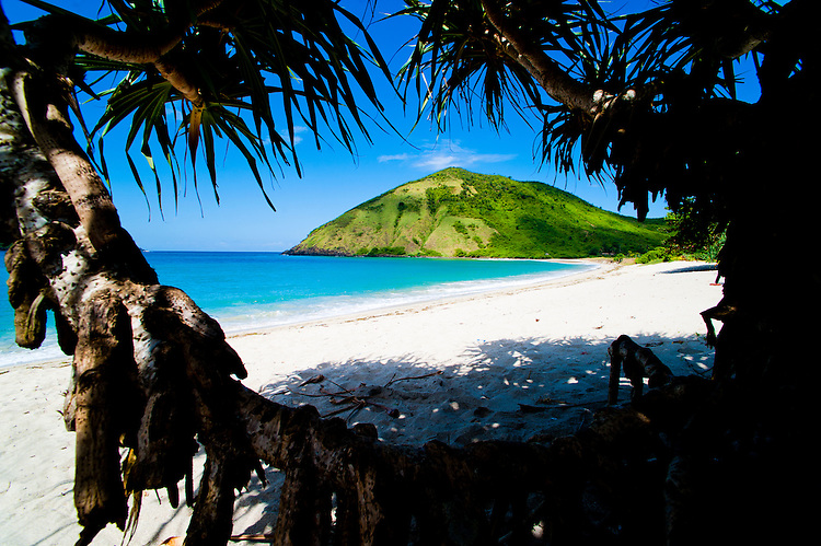 White Sands at Mawun Beach in the South of Lombok, a Tropical Paradise, Indonesia. Mawun Beach is one of the most beautiful destination in the South of Lombok. As if the half moon bay, crystal clear blue waters and perfect white sands of Mawun Beach weren't enough, you can enjoy this beach paradise completely to yourself.