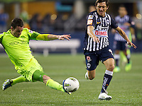 Seattle Sounders FC defender Zach Scott tries to kick the ball away from CF Monterrey forward Neri Cardozo during a CONCACAF Champions League match at CenturyLink Field in Seattle Tuesday Oct. 18, 2011. CF Monterrey won the game 2-1.