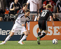 Dax McCarty (10) of D.C. United takes the ball from David Beckham (23) of the Los Angeles Galaxy during an MLS match at RFK Stadium, on April 9 2011, in Washington D.C.The game ended in a 1-1 tie.