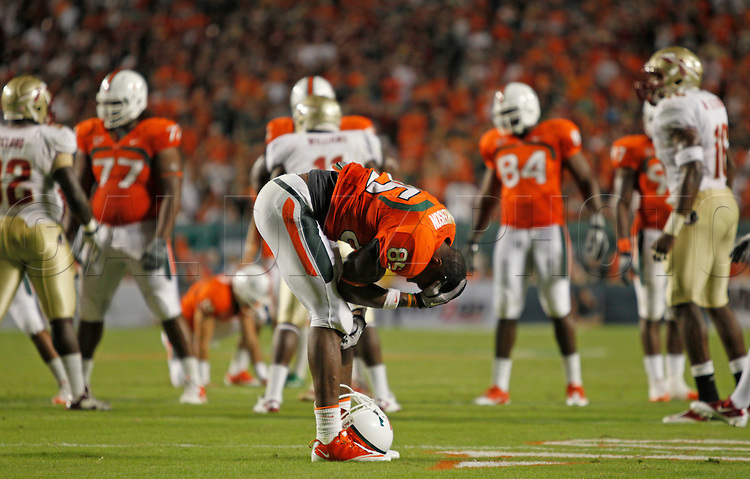 Miami's Leonard Hankerson holds his head after a hit in the third quarter during the University of Miami vs Florida State University on Saturday October 9, 2010.
