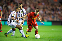 LIVERPOOL, ENGLAND - Thursday, October 4, 2012: Liverpool's Fabio Borini in action against Udinese Calcio's Medhi Benatia during the UEFA Europa League Group A match at Anfield. (Pic by David Rawcliffe/Propaganda)