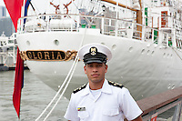 A cadet poses next to the Colombian training ship ARC Gloria during 2012 Fleet Week in New York City