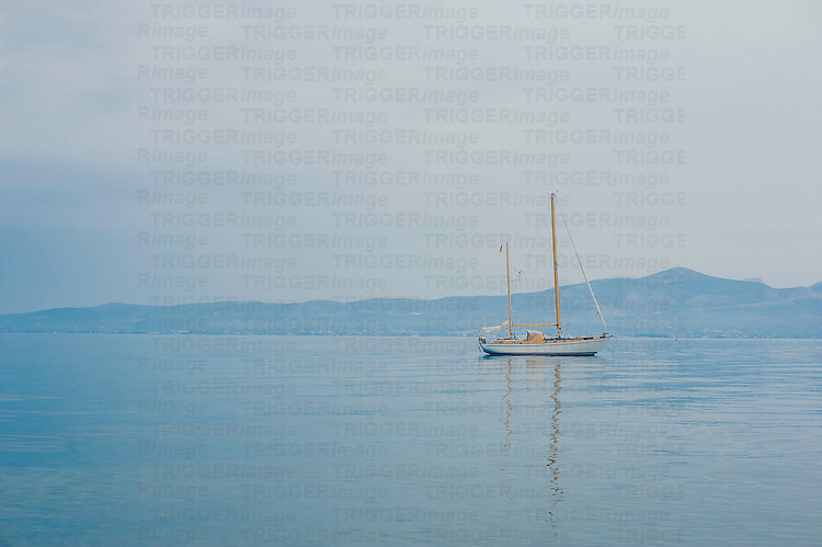 A pleasure boat moored on calm blue waters in Greece