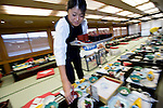 """Staffer Natsumi Takagi sets the tables in preparation for an evening aboard a """"Yakata-bune"""" pleasure boat run by the Yasuda family in Tokyo, Japan on 31 August  2010. .Photographer: Robert Gilhooly"""
