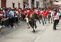 "People gather to watch an Easter tradition in Ayacucho, Peru, known as ""Pascua Toro"" or Easter Bull. Several bulls are pulled by horses, one by one, to the Plaza de Armas and many try to run with the bull, as in the Spanish tradition."