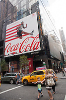 Advertising for Coca-Cola in Times Square in New York on Wednesday, July 18, 2012 promotes their involvement with the Olympics. (© Richard B. Levine)
