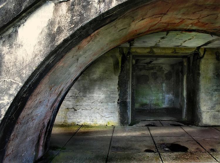 A concrete arch in an underground interior