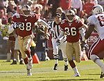 San Francisco 49ers defensive back Ronnie Heard (38) with blocking help from defensive back Jason Webster (36) runs back intercepted ball on Sunday, October 27, 2002, in San Francisco, California. The 49ers defeated the Cardinals 38-28.