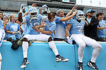 12 September 2015: UNC's Kedrick Davis (left) and Austin Proehl (7) jump into the stands before the game. The University of North Carolina Tar Heels hosted the North Carolina A&T State University Aggies at Kenan Memorial Stadium in Chapel Hill, North Carolina in a 2015 NCAA Division I College Football game.