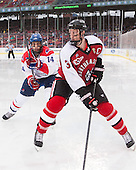 Joseph Pendenza (UML - 14), Josh Manson (NU - 3) - The Northeastern University Huskies defeated the University of Massachusetts Lowell River Hawks 4-1 (EN) on Saturday, January 11, 2014, at Fenway Park in Boston, Massachusetts.
