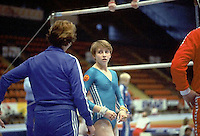 Gabrielle Fahnrich of East Germany prepares to perform on uneven bars at 1985 European Championships in women's artistic gymnastics at Helsinki, Finland in late April, 1985.  Photo by Tom Theobald.