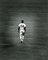 Willie Mays walks to his position in center field. This was Willie's last game with the San Francisco Giants.before he was traded to the Mets in 1972..(copyright photo 1972 by Ron Riesterer)