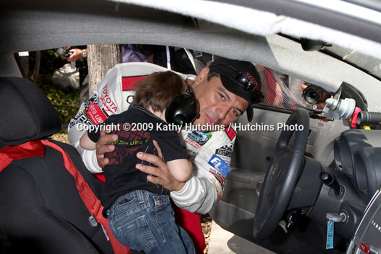 Carlos Mencia & Son Lucas Pablo Mencia  at the  Toyota Pro/Celeb Race Day on April 18 ,2009 at the Long Beach Grand Prix course in Long Beach, California..©2009 Kathy Hutchins / Hutchins Photo....                .