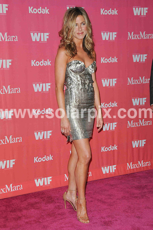 **ALL ROUND PICTURES FROM SOLARPIX.COM**.**SYNDICATION RIGHTS FOR UK, AUSTRALIA, DENMARK, PORTUGAL, S. AFRICA, SPAIN & DUBAI (U.A.E) ONLY**.arrivals for the Women In Film 2009 Crystal + Lucy Awards. Held at The Hyatt Regency Century Plaza Hotel, Los Angeles Ballroom, Los Angeles, CA, USA. 12 June 2009.This pic: Jennifer Aniston..JOB REF: 9258 PHZ (Charlotte)   DATE: 12_06_2009.**MUST CREDIT SOLARPIX.COM OR DOUBLE FEE WILL BE CHARGED**.**ONLINE USAGE FEE GBP 50.00 PER PICTURE - NOTIFICATION OF USAGE TO PHOTO @ SOLARPIX.COM**.**CALL SOLARPIX : +34 952 811 768 or LOW RATE FROM UK 0844 617 7637**