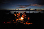 Fisherfolk gather around a fire before dawn in Karonga, a town in northern Malawi. Fish from Lake Malawi, which is bordered by Malawi, Tanzania and Mozambique, provide an important part of people's diet in this area.