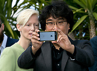 Actress Tilda Swinton and director Bong Joon-Ho attend the photocall of the movie 'Okja' during the 70th Annual Cannes Film Festival at Palais des Festivals in Cannes, France, on 19 May 2017. - NO WIRE SERVICE · Photo: Hubert Boesl/dpa /MediaPunch ***FOR USA ONLY***