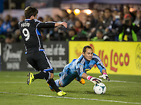 March 10th, 2013: Luis Robles dives to save the ball away from Mike Fucito during a game at Buck Shaw Stadium, Santa Clara, Ca.   Earthquakes defeated Red Bulls 2-1