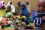 The female relations of patients at the Kwali Rehabilitaion Center in Kano sit with their children in one the center's courtyards. Much of the cooking, cleaning, and care provided to patients at recovery centers come from such relatives. Singer Natalie Imbruglia and UNFPA, the United Nations Population Fund, are working to bring awareness to obstetric fistula, a devastating injury of childbirth that affects more than two million women in developing countries, particularly Nigeria where half of known cases are found. The condition, caused by damage to the walls of the vagina during protracted labor, usually leads to the death of the child and leaves affected women incontinent and often disowned by their husbands and communities.