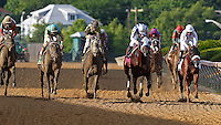 May 18, 2012 Alternation (blue stripes, #8) Luis Quinonez up, wins the Pimlico Special at Pimlico Race Course in Baltimore, Maryland. photo by Joan Fairman Kanes