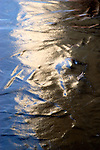 Reflected light captured on the uneven surface of Lake Nokomis