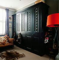 The master bedroom has a sitting area with a sofa and a free-standing wardrobe